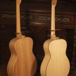 The guitar on the left is built with palo escrito, the other is red maple.