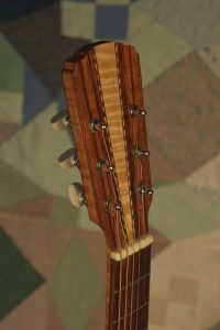 Orchestra guitar no 14 headstock front in hormigo with a maple wedge