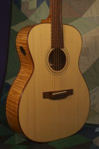 Orchestra guitar no 14 uses red maple sides and back and an Adirondack spruce top.
