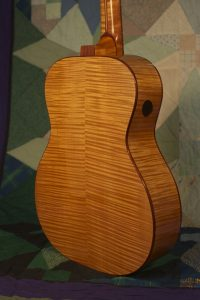 Orchestra guitar no 14 uses red maple sides and back.