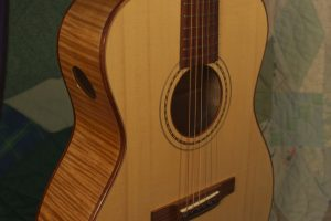 Orchestra guitar no 14 adds a soundport in the side to give the player a rich, direct sound.