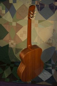 Orchestra guitar no 15 features palo escrito sides and back.
