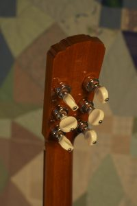 Orchestra guitar no 15 uses Waverly banjo tuners in keeping with the OM heritage.