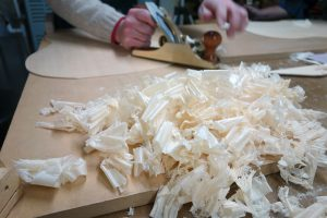 I'm using a razor-sharp hand plane to thickness this Engelmann spruce top. Photo by Denny Brown/Robbie O'Brien.