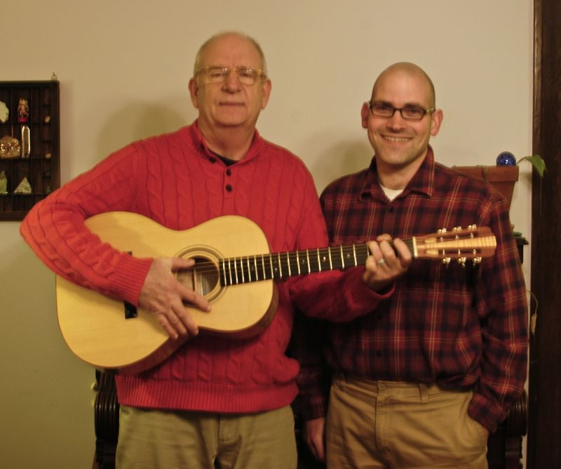 The buyer of no. 3 (left) and I pose with the guitar.