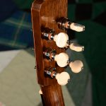 Orchestra guitar headstock, rear