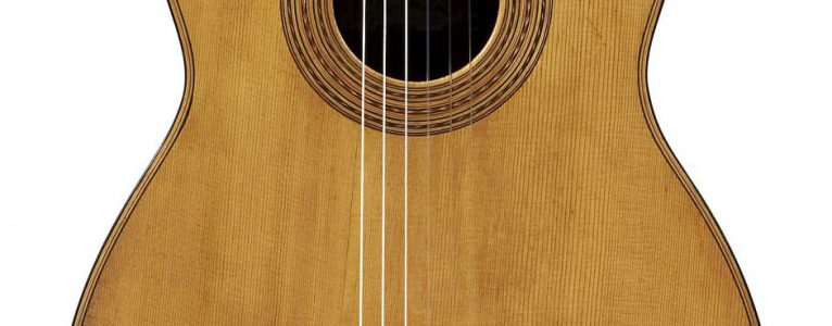 The front of a guitar built by Antonio Torres. The spruce top is built up from at least three pieces.