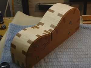 Maple guitar sides taped to a solid form.