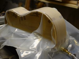 Guitar sides being clamped together in a vacuum press bag.