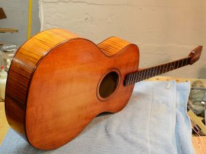 Spruce tops often have more curl than you think, and the dye accentuates the natural figure.