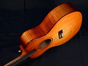 The Adirondack spruce top from Old Standard Wood glows under the shellac and dye finish.