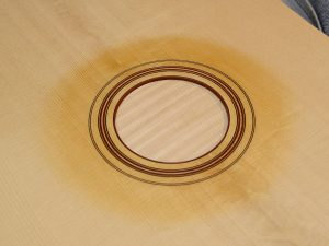 The rosette has been inlaid and is looking sharp. Check out the curl in the spruce top!