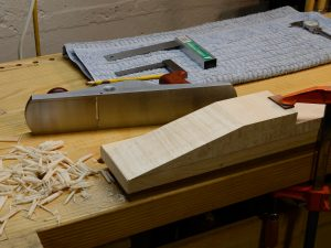 Working the neck scarf joint surfaces down with a smoothing plane.