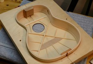 Here I'm checking to make sure the top fits the rims before gluing the box closed.
