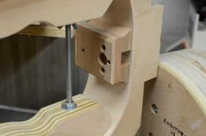 This neck block allows adjustment of the neck's angle.