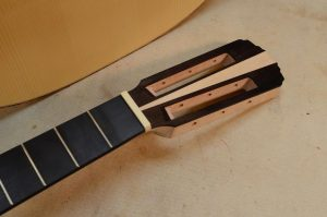 I've slotted the headstock and shaped and sanded the transtions and overall shape.