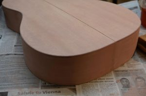 Pore filled applied and mostly sanded back to wood.