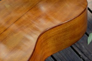 Rosewood binding forms the edges of this American sycamore guitar.