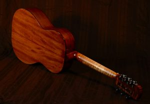 This guitar sports a red maple neck with nice flame.