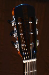 The headstock has a central strip of sycamore surrounded by African blackwood. The tuners are Rubner 3-on-a-plates with ebony buttons.