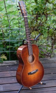 Front view of no22, a grand concert in red spruce and sugar maple with a toned finish.