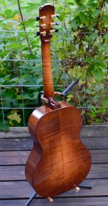 Rear view of no22, a grand concert in red spruce and sugar maple with a toned finish.