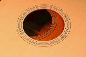 The rosette and soundhole of a guitar top