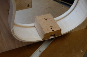 The neck block of a guitar rib set