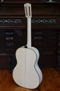 An assembled unfinished guitar