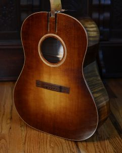 My J45-inspired guitar sports a rectangular Honduran rosewood bridge.