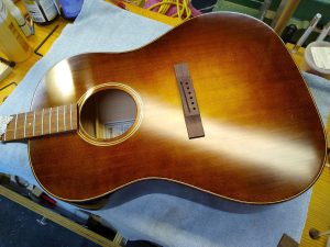 A guitar top with a newly glued-on bridge