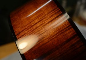 The side of a maple guitar with sunburst color applied