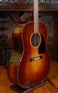 The front of a slope-shouldered dreadnought guitar