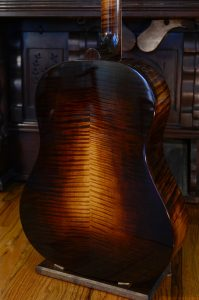 The back of a slope-shouldered dreadnought guitar